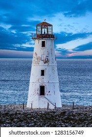 An old lighthouse on a point of land in the Bahamas near Nassau