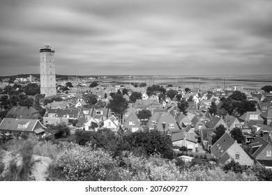 Old lighthouse in a small village on the island Terschelling in the Netherlands - long exposure shot (black and white)