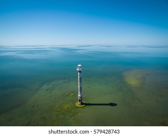 Old lighthouse standing in the sea, aerial panoramic view. Estonia, Saaremaa island - Kiipsaare tuletorn.