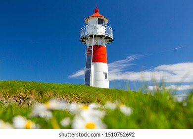 Old lighthouse in Torshawn city - the capital of The Faroe Islands, Denmark.