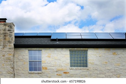 Old limestone house with a solar panels on a roof