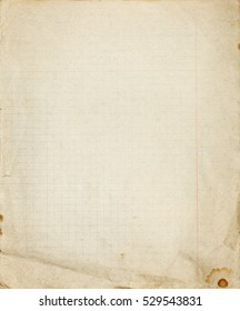 Old lined school paper copybook page with crumled messy lower part and stains