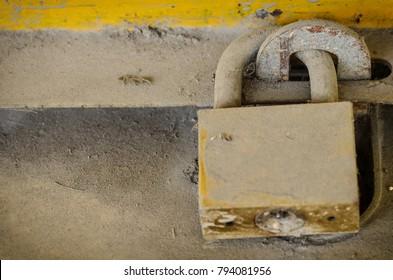 old lock and key on dust door