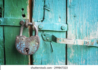 Old lock on the door. lock on the door of an old farmhouse . true village style . close-up. focus on lock