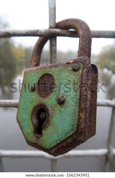 an old lock on the fence