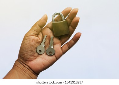 The old Lock and two keys on hand with white background