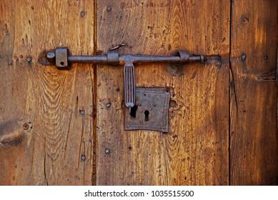Old lock in a wood door