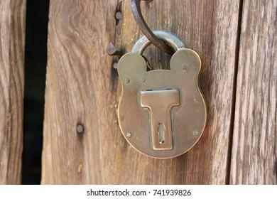 Old locked antique padlock macro