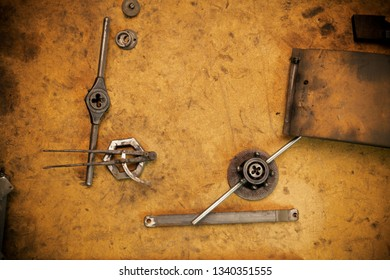 Old locksmith tools for threading, close up, copy space