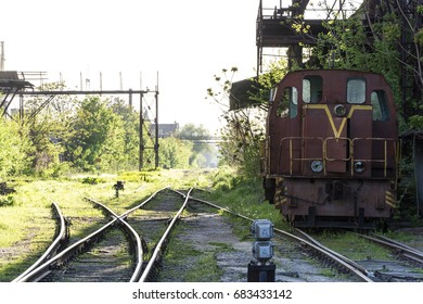 The old locomotive is on a spare line