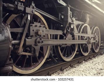 Old locomotive wheels close up.