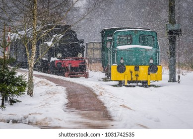 Old locomotives at former railroad station Bialowieza Towarowa in Bialowieza, large village in Podlasie region of Poland - Shutterstock ID 1031742535