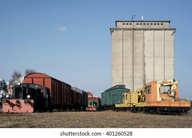 old locomotives and railway carriages on the siding