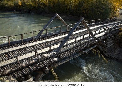 Old log bridge over river near Haines Junction, Yukon, Canada. Part of the original Alaska Highway