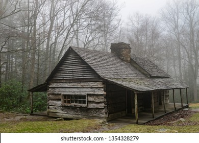 Old log cabin in the woods.