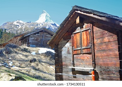 Old log cabins and the Matterhorn in the Spring, above Zermatt in the Swiss Alps
