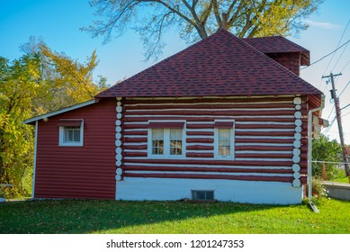 Old log home painted red