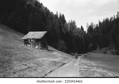 Old log huts for animal shelters in the Swiss Alps, with analogue photgraphy - 2