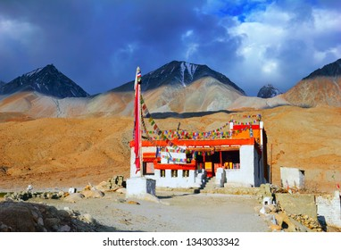 Old lonely buddhist gompa (monastery) against the background of barren mountain range and stormy dramatic sky, Merak village, Pangong lake, Ladakh, Himalaya, Jammu & Kashmir, Northern India