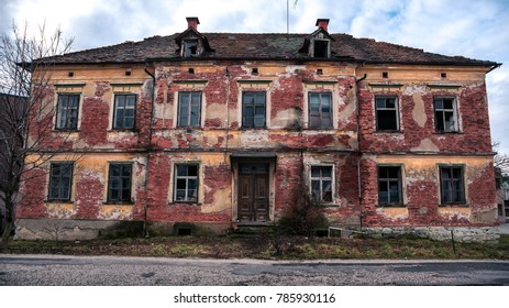 Old, long abandoned and derelict brick house in city Celje.