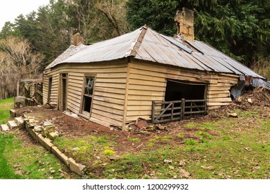 An Old, Long Abandoned Farmhouse, Falling Apart and Sagging Into the Earth
