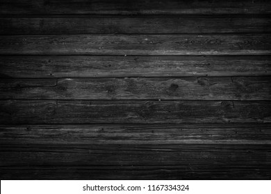 Old, long  logs. Black texture of wood.