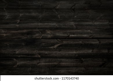 Old, long  planks. Black texture of  wood.