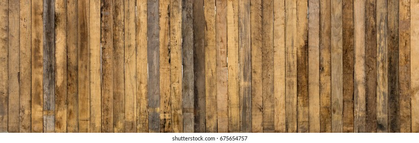 Old long rectangular vertical wooden wall with stains to create ancient shops.