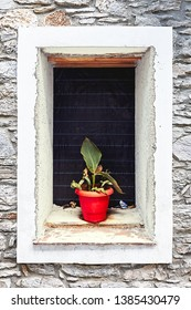 An old looking Window photographed in Greece - Image
