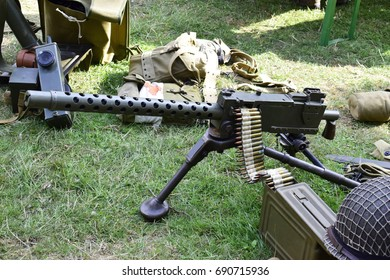 Old machine gun with bullets on a grass, prepare for fight.
