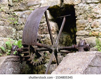 old machine parts remind of the existence of the old water mill at Dolny Mlyn in Bohemian Switzerland national park