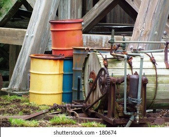 Old machinery and barrels under bridge