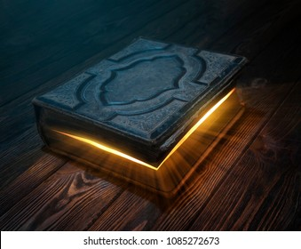 Old magic book on wooden table with light rays coming out form the inside