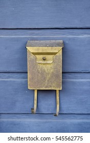 Old mail box on purple house - New Orleans, LA, USA