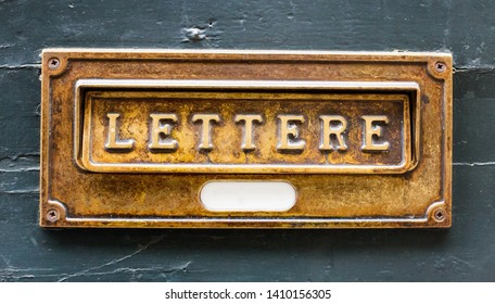 Old mailbox slot for letters and telegrams in a wood wall in Bergamo city, Italy - Image
