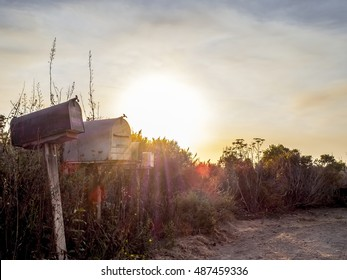 Old mailboxes in california at sunset