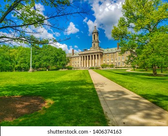OLD MAIN BUILDING, UNIVERSITY PARK,  PA - MAY 16, 2019: A photo from the path to the Old Main Building and lawn on Penn State University's Main Campus in University Park, PA