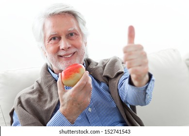 old man with apple