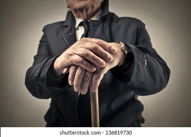old man with a baton