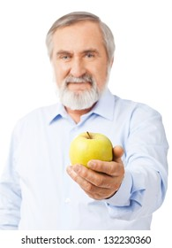 An old man with a beard holds out a yellow-green apple. Isolated on white background.