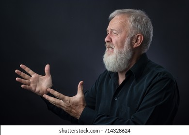 Old man with beard praying for someone and asking for something. Father to the prodigal son.