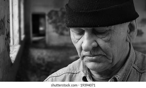 old man in black hat