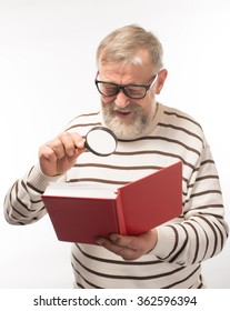 old man with a book with glasses