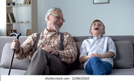 Old man and boy laughing genuinely, joking, valuable fun moments together