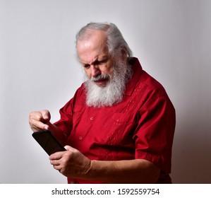 Old man in bright red shirt  reacting to the news that the car repair bill will cost an arm and a leg.     Receives a message that the devil is in the details regarding his mortgage.