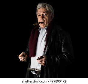 Old man with cigar in his mouth