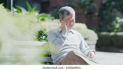 old man depressed and forget something outdoor