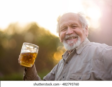 Old man drink beer outdoor