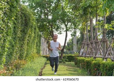 old man exercise by jogging at the park, health concept
