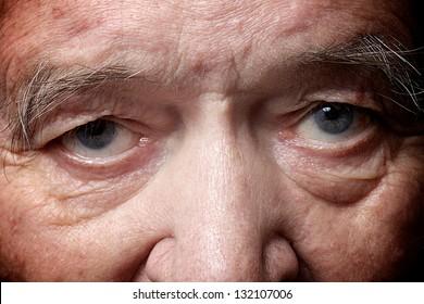 old man face part closeup eyes looks at camera